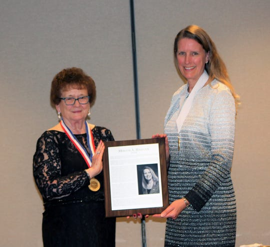 Dr. Merodie A. Hancock, president, Thomas Edison State University, right, receives her plaque from Chair Dian Stoskopf, left, after installation in the International Adult and Continued Education Hall of Fame.
