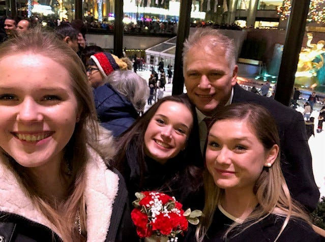 Tim Vollenbroek of Woodbridge is pictured with his three daughters on Christmas Eve at Rockefeller Center. The family makes an annual holiday pilgrimage, but this year, the trip was made even more special when Vollenbroek married his longtime girlfriend, Cathy Fitzpatrick.