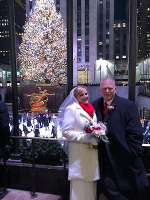 Cathy Fitzpatrick and Tim Vollenbroek of Woodbridge made their annual Christmas Eve pilgrimage to the Rockefeller Center Tree a little more special this year. The couple of 14 years got married under it surrounded by family and friends.