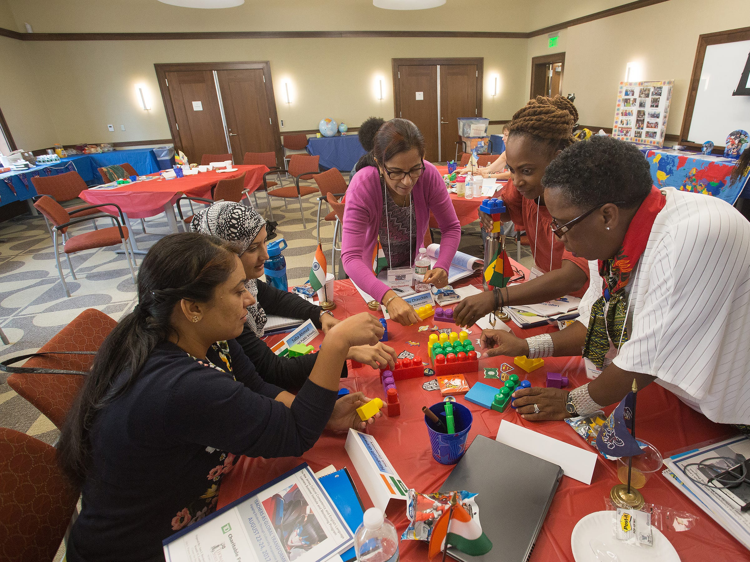 Early childhood educators participate in The Art of Change simulation using LEGO blocks during the 2017 N.J. Cultural Competency and English Language Learners Institute and Mentoring Program (ELL) at Thomas Edison State University. Participants (from left to right) Hargurjit Grewal, Saba Ahmed and Ritu Chauhan learn lessons they'll take back to their classrooms from ELL mentors Nilajah Abdullah and Dee Bailey.