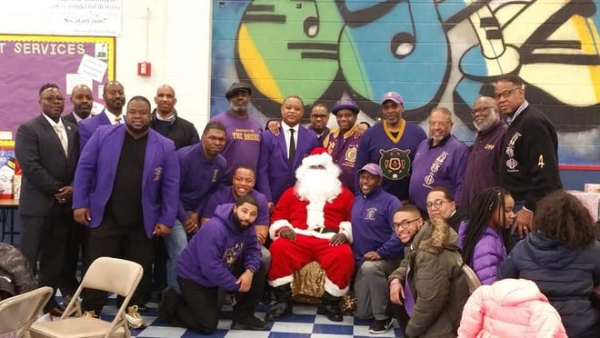 """Omicron Chi Chapter of Omega Psi Phi Fraternity Incorporated hosted its annual """"Kids Deserve Toys"""" event on Saturday, Dec. 22."""