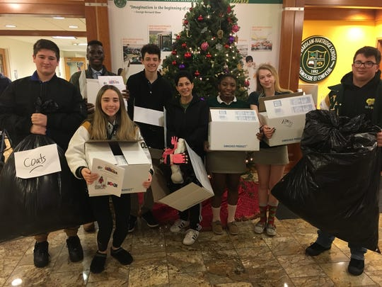 Students at The Wardlaw+Hartridge School in Edison gather the many items collected during this year's holiday coat drive. Pictured, from left: Ryan Brace of Scotch Plains, Alvari Mhya of Carteret, Elizabeth Ostrowski of South River, Vincent Alvarez of South Bound Brook, Director of Student Life Dawn Francavilla of Somerset, Taliyah Williams of Plainfield, Olivia Brown of South Plainfield and AJ Massaro of South Plainfield. The school donated more than 100 coats and three boxes of brand new winter accessories including hats, gloves, mittens and scarves. All donations went to Hands of Hope in Edison.