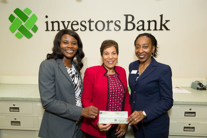 (Left to right) Beryl Sowah,program director of JFK's Plainfield Health Connections and Donna M. Meade, president of Hackensack Meridian Health JFK Medical Center Foundation, accepts a check from DeAngelina Inman, assistant vice president and branch manager, Investors Bank, Clara Barton Branch.