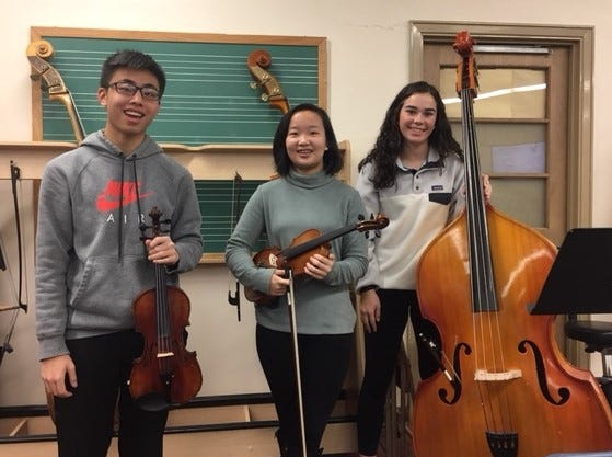 Left to right: Westfield High School senior Kevin Li, freshman Amy Xiao and sophomore Kelly Eagan will perform with the CJMEA Region II Orchestra on January 6.