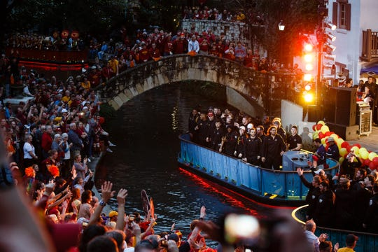 Iowa State fans cheer as the ISU football team floats through on the river around the Arneson River Theater during the Rudy's Bar-B-Q Pep Rally on Wednesday, Dec. 26, 2018, in San Antonio. Iowa State takes on Washington State in the Valero Alamo Bowl on Friday.
