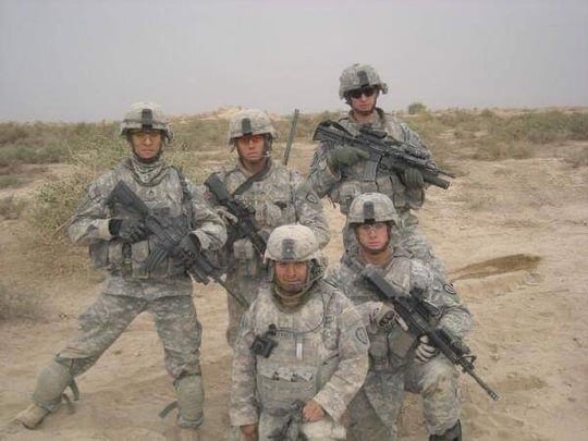 Jason Ogletree, top middle, pictured with some of his fellow servicemen in Iraq in 2009.