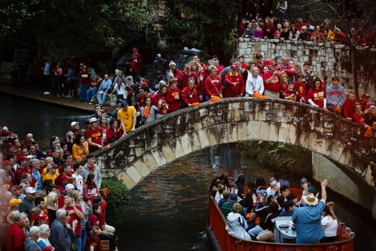 Iowa State and Washington State fans line the River Walk around the Arneson River Theater for the Rudy's Bar-B-Q Pep Rally on Wednesday, Dec. 26, 2018, in San Antonio. Iowa State takes on Washington State in the Valero Alamo Bowl on Friday.