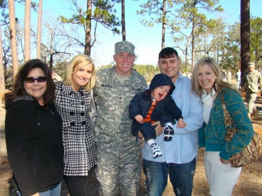 Jason Ogletree, with his ex-wife Micole Van Walbeek to his right, shown in his military uniform after his Ranger school graduation in 2011.