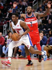 Detroit Pistons guard Langston Galloway (9) drives to the basket past Washington Wizards guard John Wall (2) during the first half of an NBA basketball game Wednesday, Dec. 26, 2018, in Detroit.