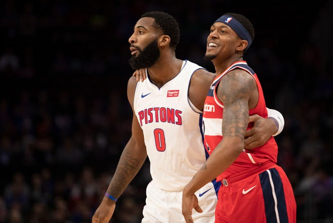 Washington Wizards guard Bradley Beal and Detroit Pistons center Andre Drummond put their arms around each other during the first quarter at Little Caesars Arena, Dec. 26, 2018.