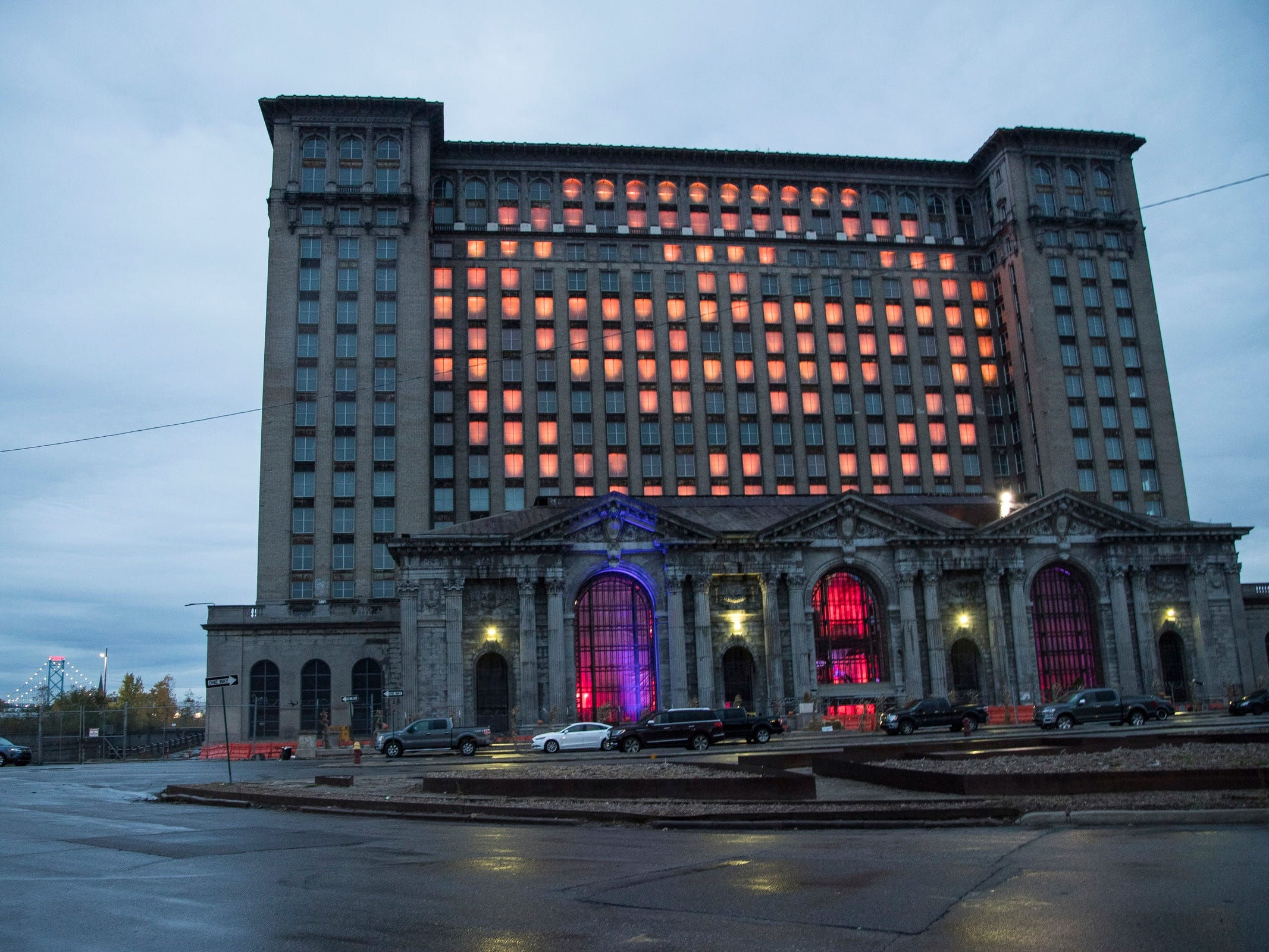 Halloween lights are projected on the windows on Michigan Central Station in Detroit, Tuesday, Oct. 30, 2018.