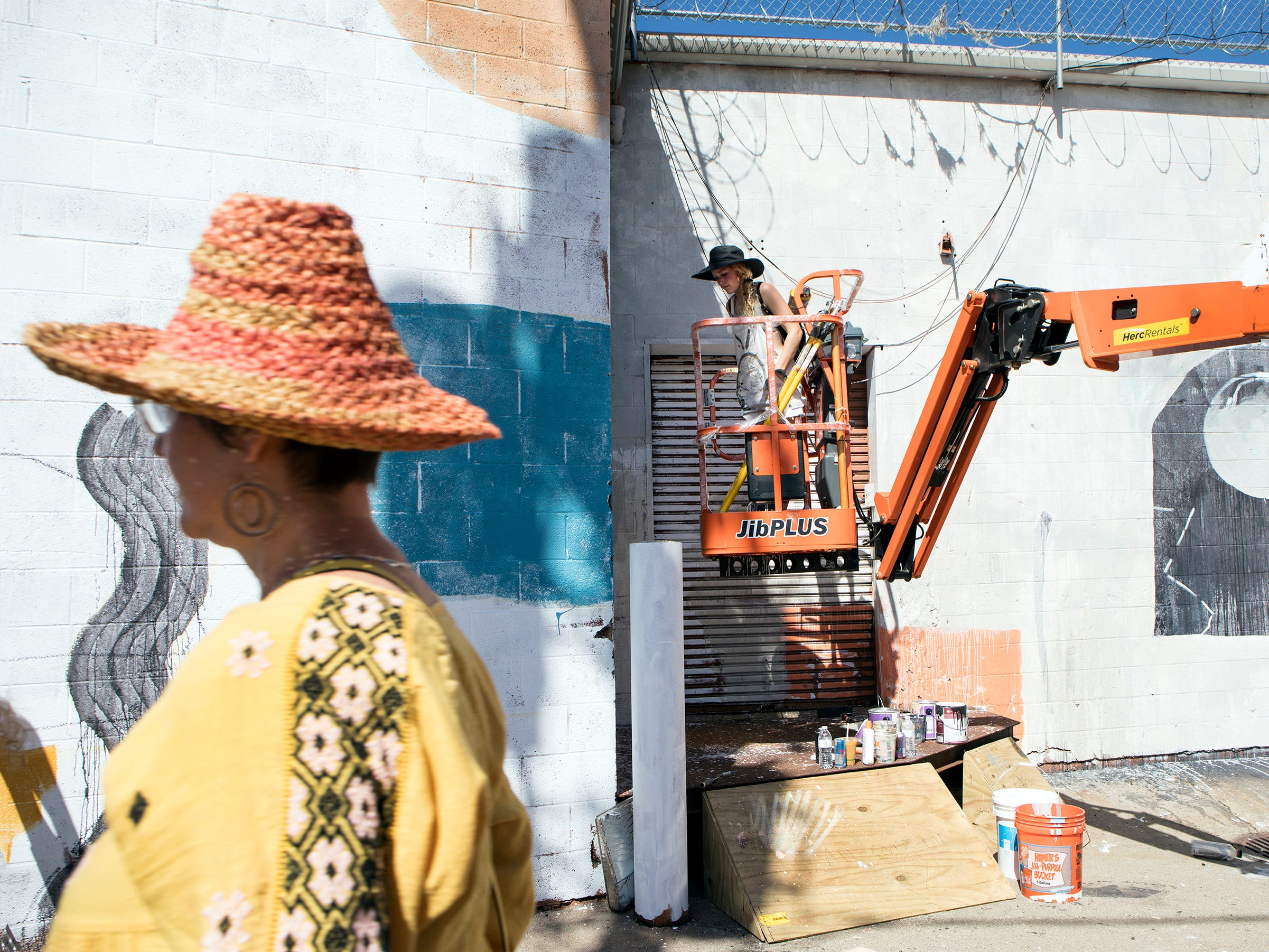 Detroit artist Ellen Rutt works on a mural commissioned by Vans at Murals in the Market in Detroit, Mich., Sunday, September 16, 2018.