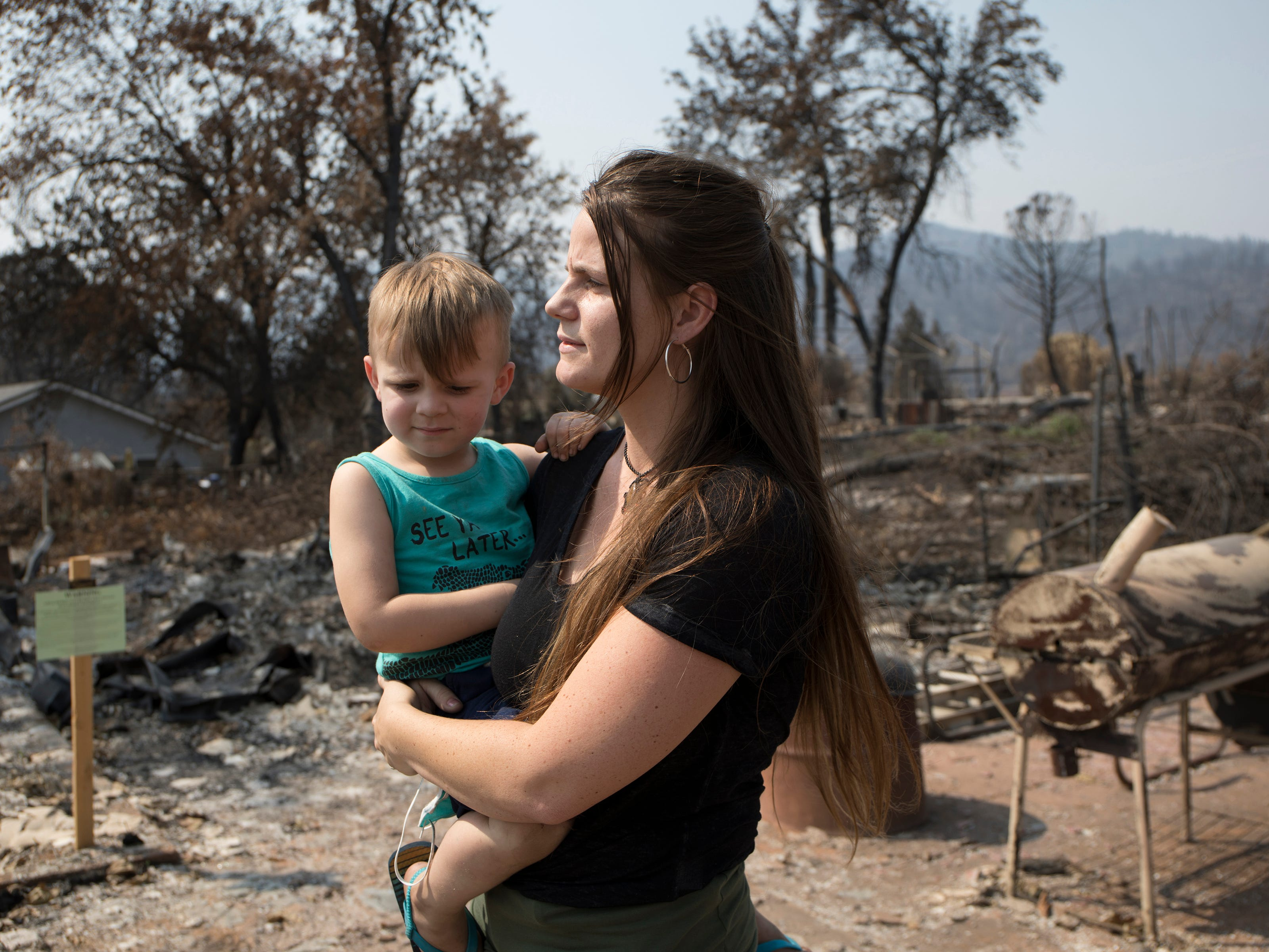 Survivors look over what is left following the Carr fire which burned down all but 2 homes in Keswick, Calif., Tuesday, August 21, 2018.