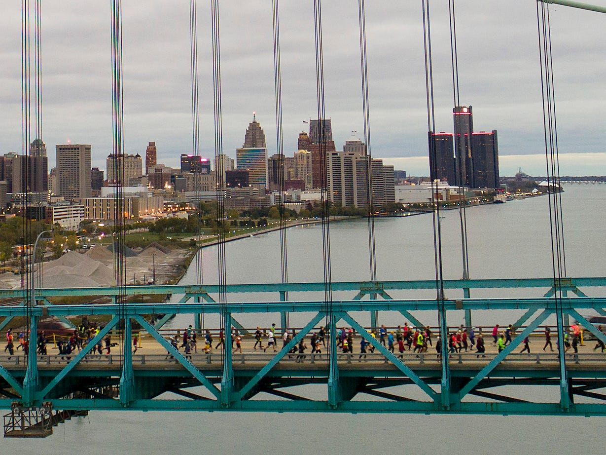 Marathoners cross into Canada via the Ambassador Bridge during the 41st Annual Detroit Free Press/Chemical Bank Marathon in Detroit on Sunday. Oct. 21, 2018. Mandi Wright and Eric Seals