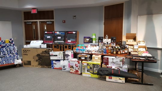 Property removed from Cas Bar on display during a press conference at the Dearborn Police Department.