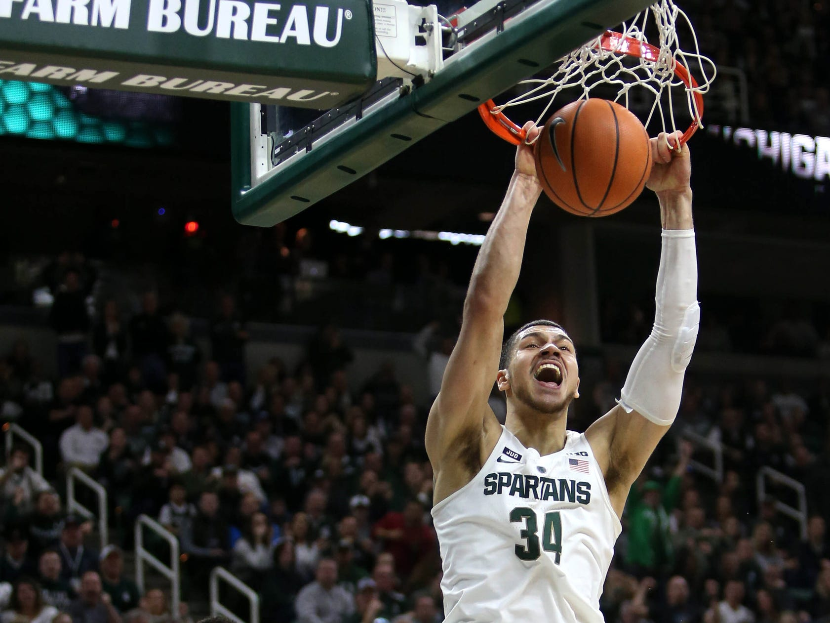 Michigan State forward Gavin Schilling scores against Purdue guard Dakota Mathias during first half action Saturday, February 10, 2018 at the Breslin Center in East Lansing, MI.