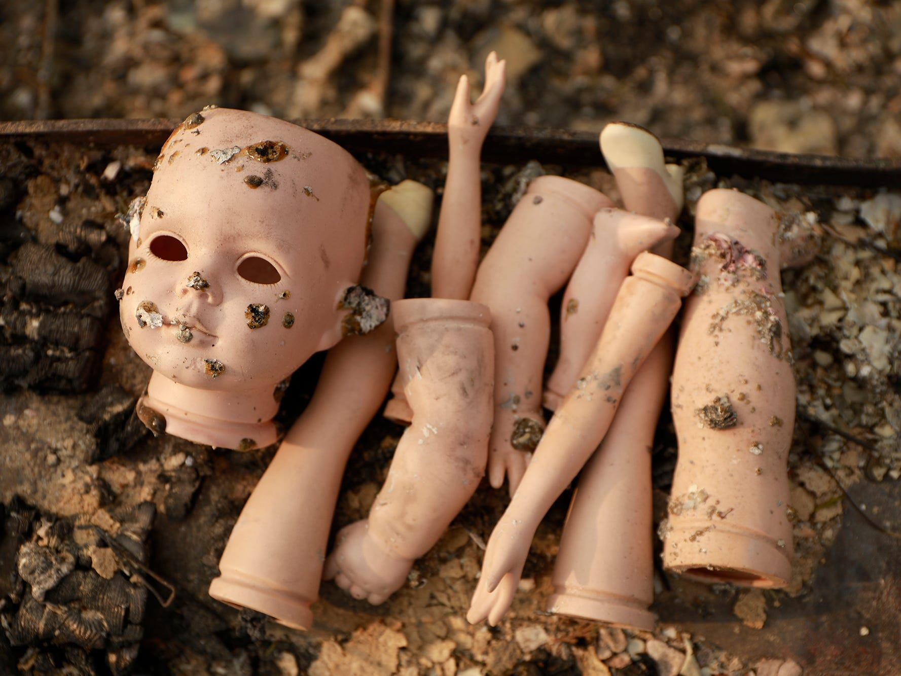 Antique doll parts remain among the ashes of a home on Keswick Rd. near Tanstaafl Lane lost to the Carr fire in Keswick, Calif., Saturday, August 26, 2018.