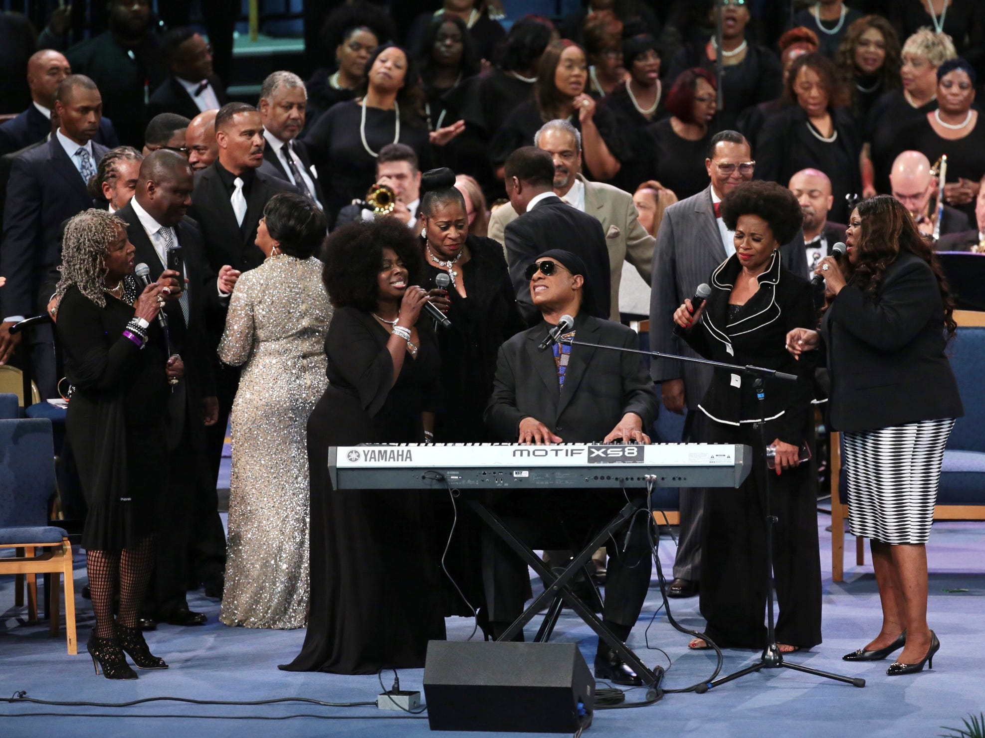 Stevie  Wonder  joined  by  national  artists performs at the end of the funeral for the late Aretha Franklin at Greater Grace Temple in Detroit on Friday, August 31, 2018.