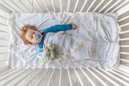 Cute Redhead Baby Boy Sleeping In The Crib