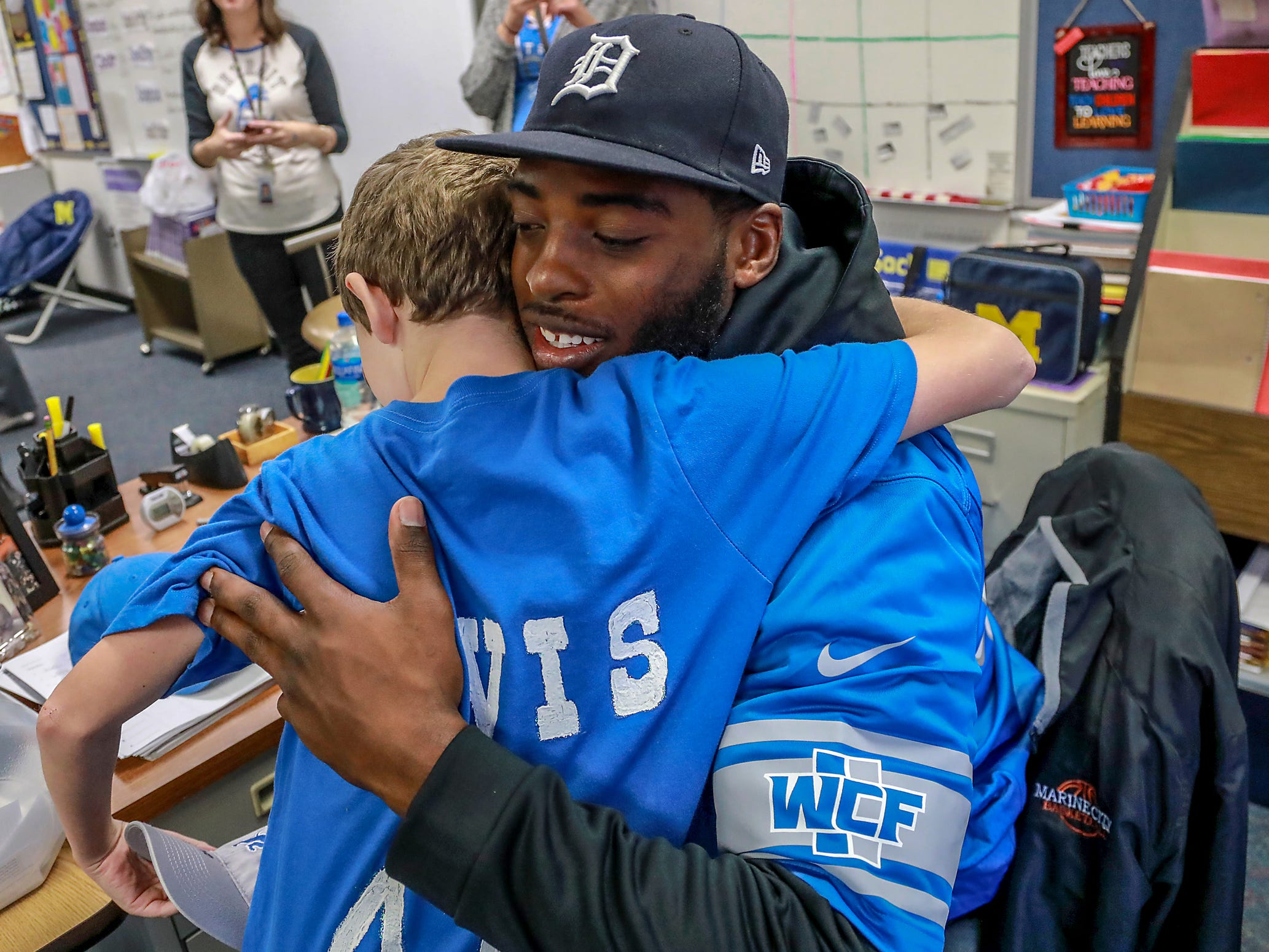 "Detroit Lions Linebacker Jarrad Davis hugs Kaleb Hartter, 9, of Harrtison Twp , who is the winner of ""Take A Lion To School"" contest hosted by National Coney Island while he visits Lobbestael Elementary School in Harrison Twp. Mich. on Tuesday, Oct. 30, 2018."