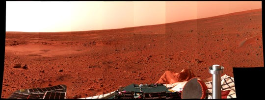 In January 2003, a Mars landscape is seen in a picture taken by the panoramic camera on the Mars Exploration Rover Spirit. The circular topographic feature, dubbed Sleepy Hollow, can be seen along with dark markings that could have bee  caused by the airbag-encased lander as it bounced and rolled to rest.