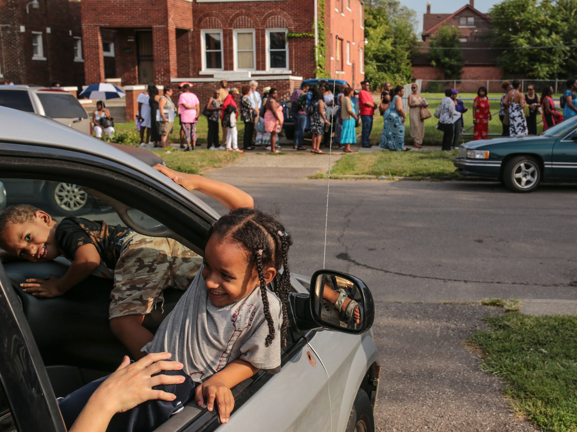 People wait in line for the start of a gospel tribute concert for the late Aretha Franklin at New Bethel Baptist Church in Detroit on Monday, August 27, 2018.