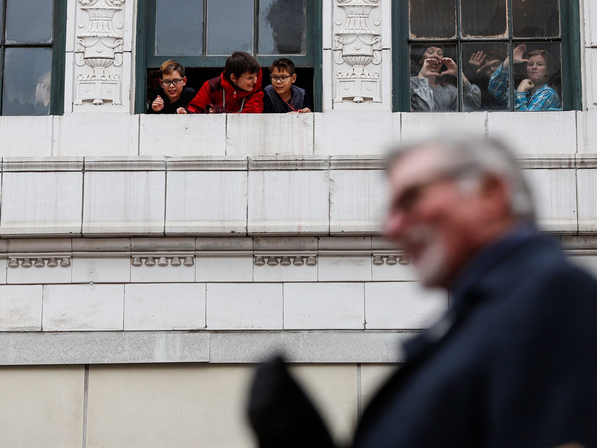 Spectators watch the parade as former Detroit Tigers's pitcher Jack Morris goes by on Woodward Avenue during the 92nd America's Thanksgiving Day Parade in Detroit, Thursday, Nov. 22, 2018.