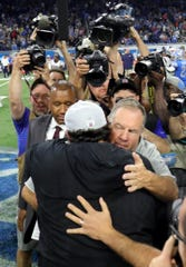 Detroit Lions head coach Matt Patricia and New England Patriots head coach Bill Belichick embrace after the Lions 26-10 win Sunday, September 23, 2018 at Ford Field in Detroit, Mich.