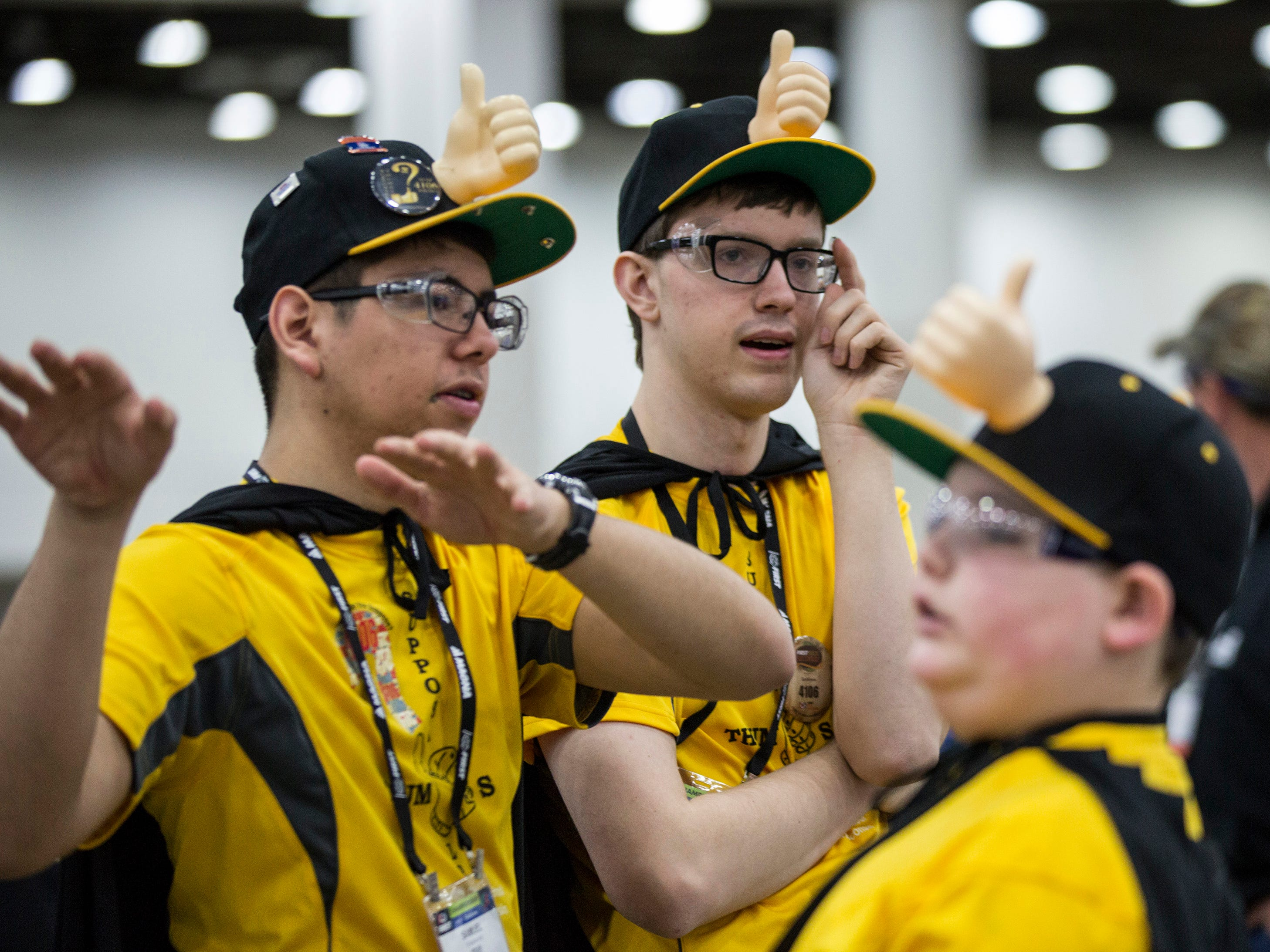From left, Samuel Castro, 17, Tim Keep, 18 and Caden Holcomb, 12 all of New Berlin, WI, talk strategy for team Supposable Thumbs at the FIRST Robotics World Championship at Cobo Center, in Detroit, Mich., Wednesday, April 25, 2018.