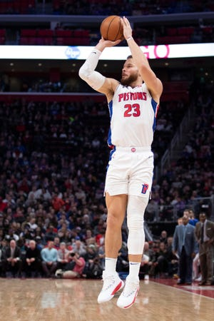 Detroit Pistons forward Blake Griffin (23) takes a shot during the third quarter against the Washington Wizards at Little Caesars Arena.