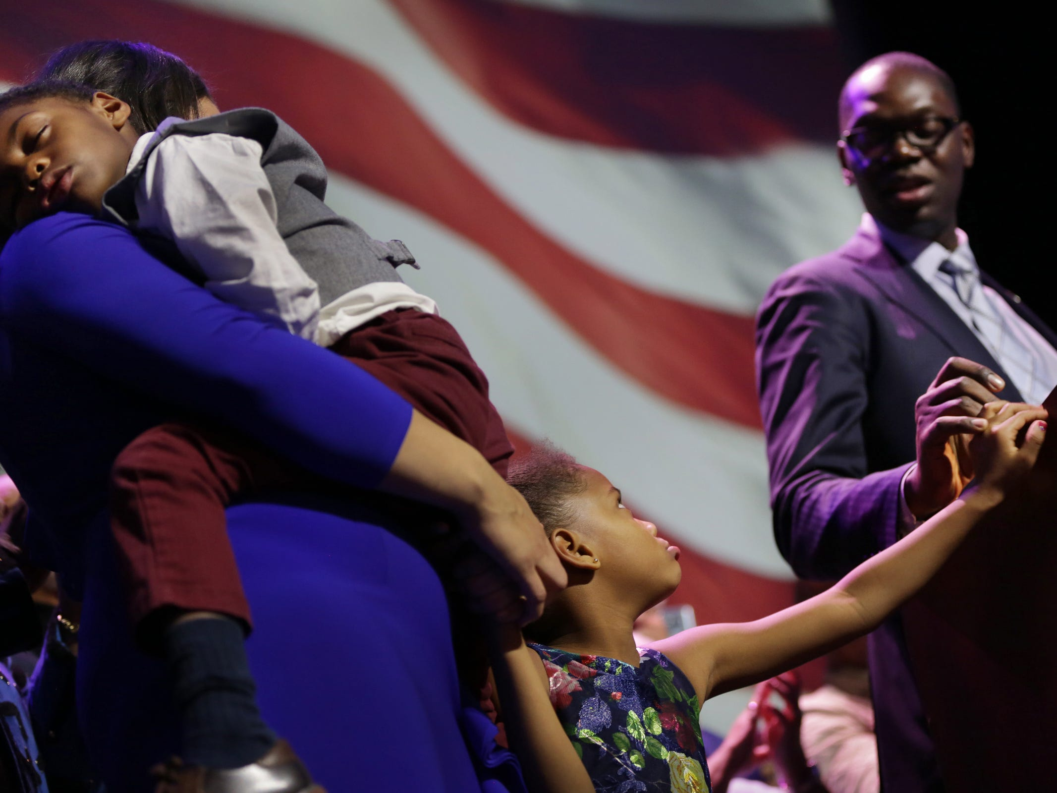 Garlin Gilchrist exchanges a look with his daughter as he speaks to the crowd celebrating his victory as Lieutenant governor with Gretchen Whitmer as governor during a celebration at MotorCity Casino's Sound Board in Detroit on Tuesday, Nov. 6, 2018.