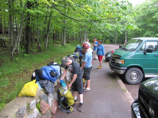 A group of young hikers from Wisconsin and Minnesota prepares to hit the trail at the Lake of the Clouds observation area in Porcupine Mountains Wilderness State Park.