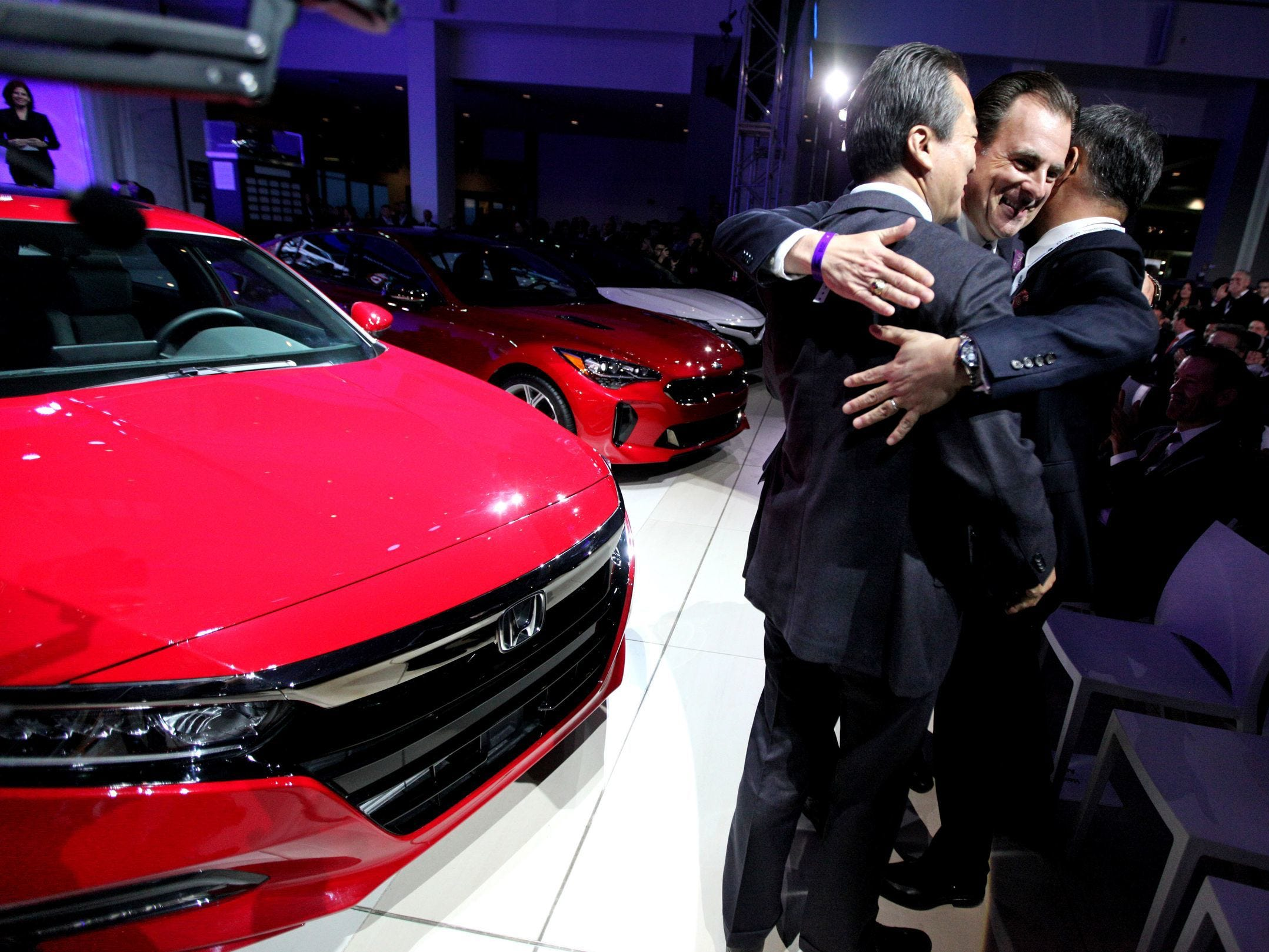 From left: Executive Vice President of Automotive Operations Masayuki Igarashi, Henio Arcangeli, Jr. is the senior vice president of the Automobile Division of American Honda Motor Co., Inc., and American Honda president & CEO Toshiaki Mikoshiba celebrate after the 2018 Honda Accord (pictured left) was named Car of the Year during the North American International Auto Show on Monday, Jan. 15, 2018 in Detroit.