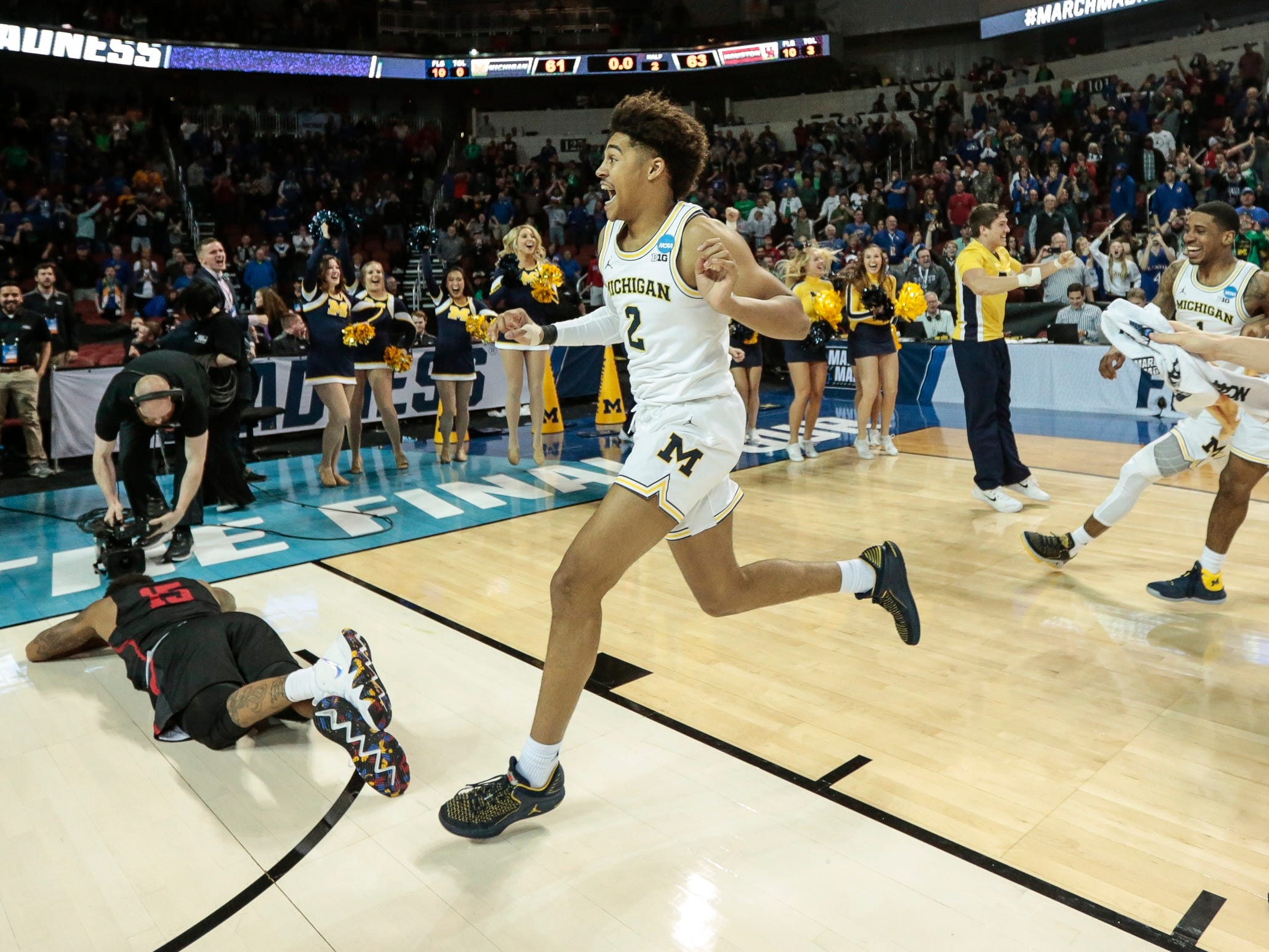 Michigan guard Jordan Poole (2) celebrates after scoring a 3-pointer to defeat Houston in the second round of the NCAA tournament at INTRUST Bank Arena in Wichita, Kan., Saturday, March 17, 2018.