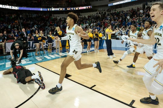 Jordan Poole celebrates after scoring a 3-pointer to defeat Houston in the second round of the NCAA tournament in Wichita, Kan., March 17.