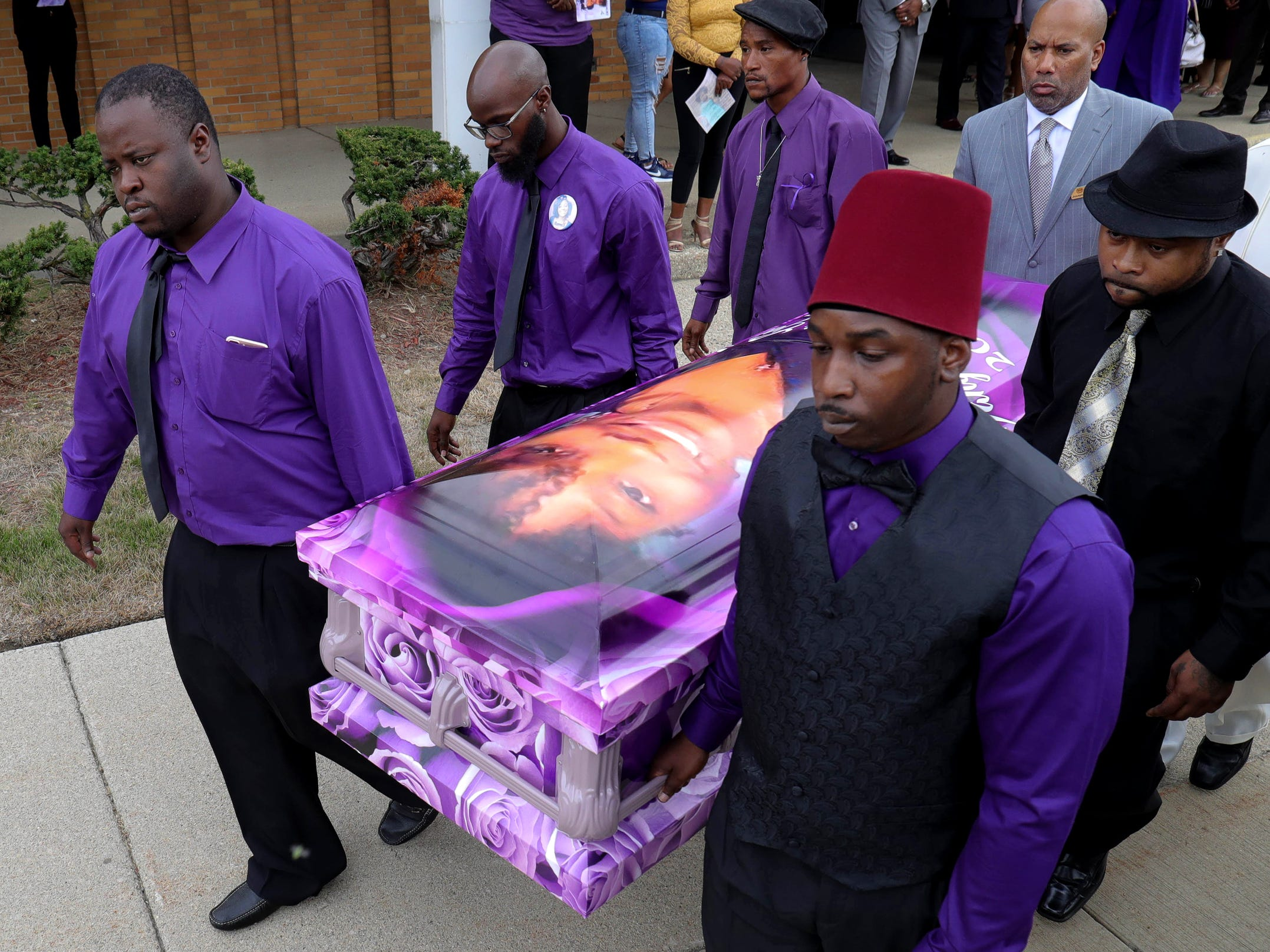 The casket of Danyna Gibson is carried from New St. Paul Missionary Baptist Church after services Wednesday, September 19, 2018 in Warren, Mich.