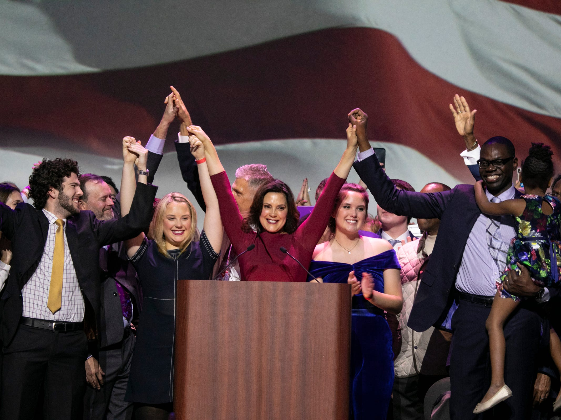 Michigan governor elect Gretchen Whitmer and her running mate Garlin Gilchrist celebrate their victory during the watch party held at the Sound Board in the MotorCity Casino in Detroit Tuesday, Nov. 6, 2018.