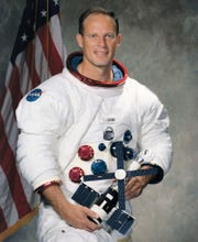 Michigan-born retired astronaut Jack Lousma.