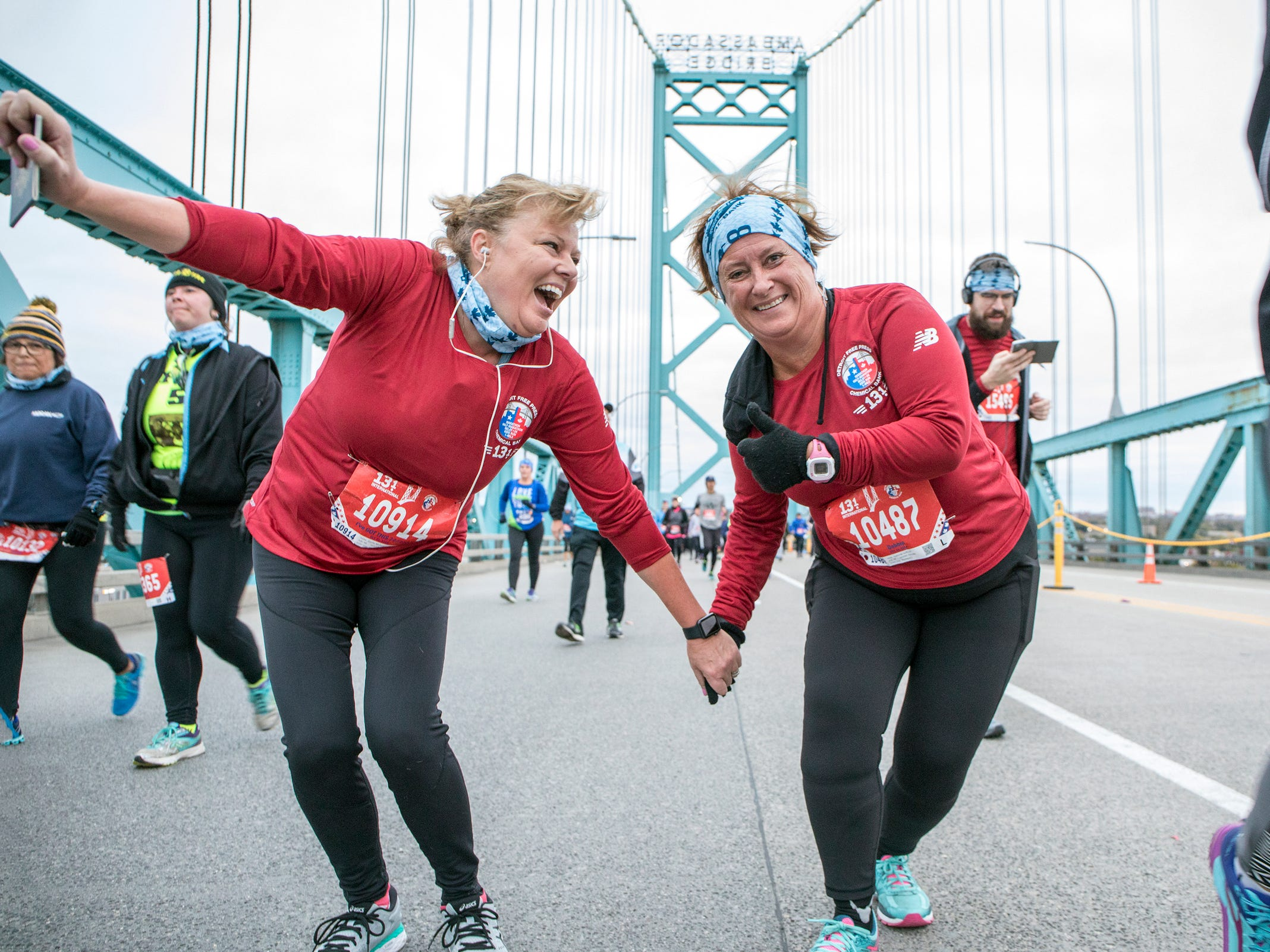 From left, Candy McGuigan, 55 of Blenheim, Canada and Deborah Griffore, 56 of Chatham, Ontario cross the Ambassador Bridge during the 41st Annual Detroit Free Press/Chemical Bank Marathon in Detroit on Sunday, Oct. 21, 2018.