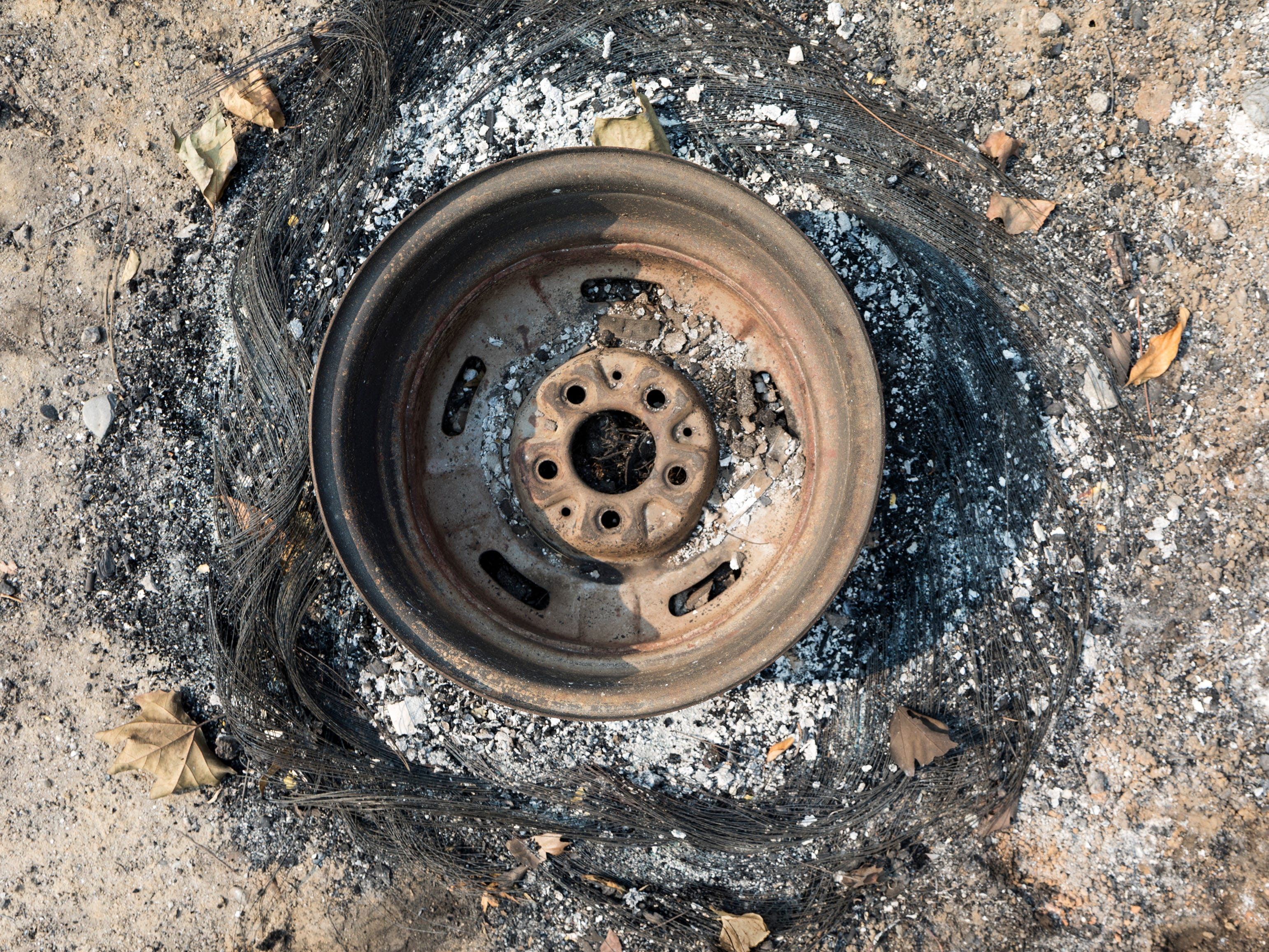 Steel cords remain of a burned tire after the intense tornado fire in Keswick, Calif., Tuesday, August 21, 2018.