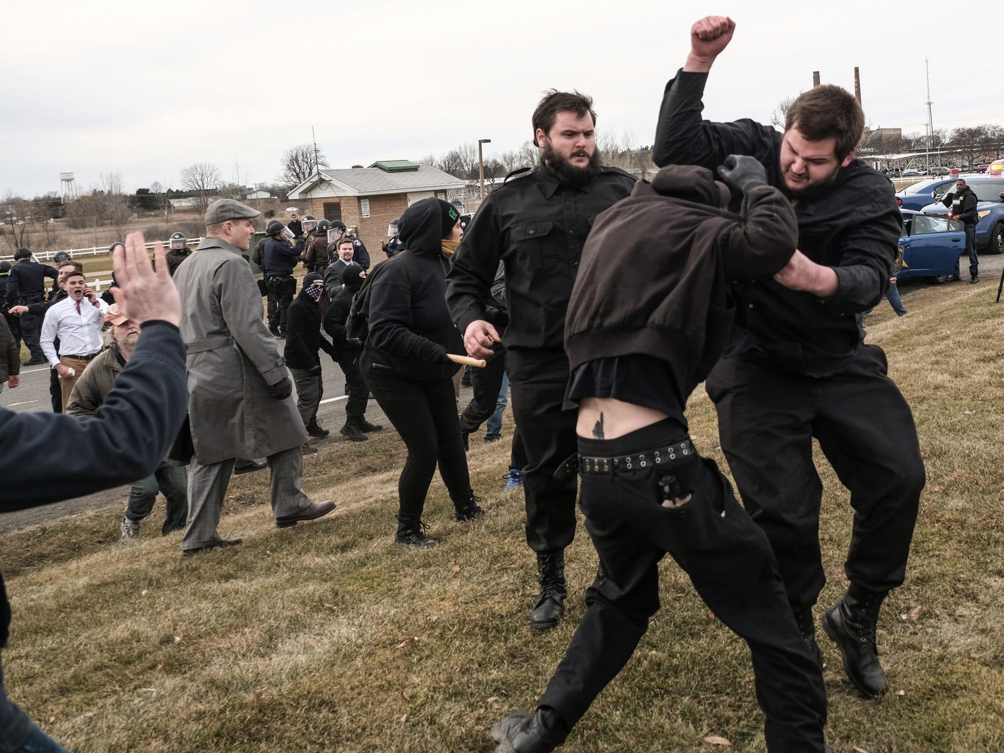 Protestors and supporters of Richard Spencer clash outside of the MSU Pavilion for Agriculture and Livestock Education on the Michigan State University campus in Lansing on Monday, March 5, 2018 where Spencer is set to speak to supporters.