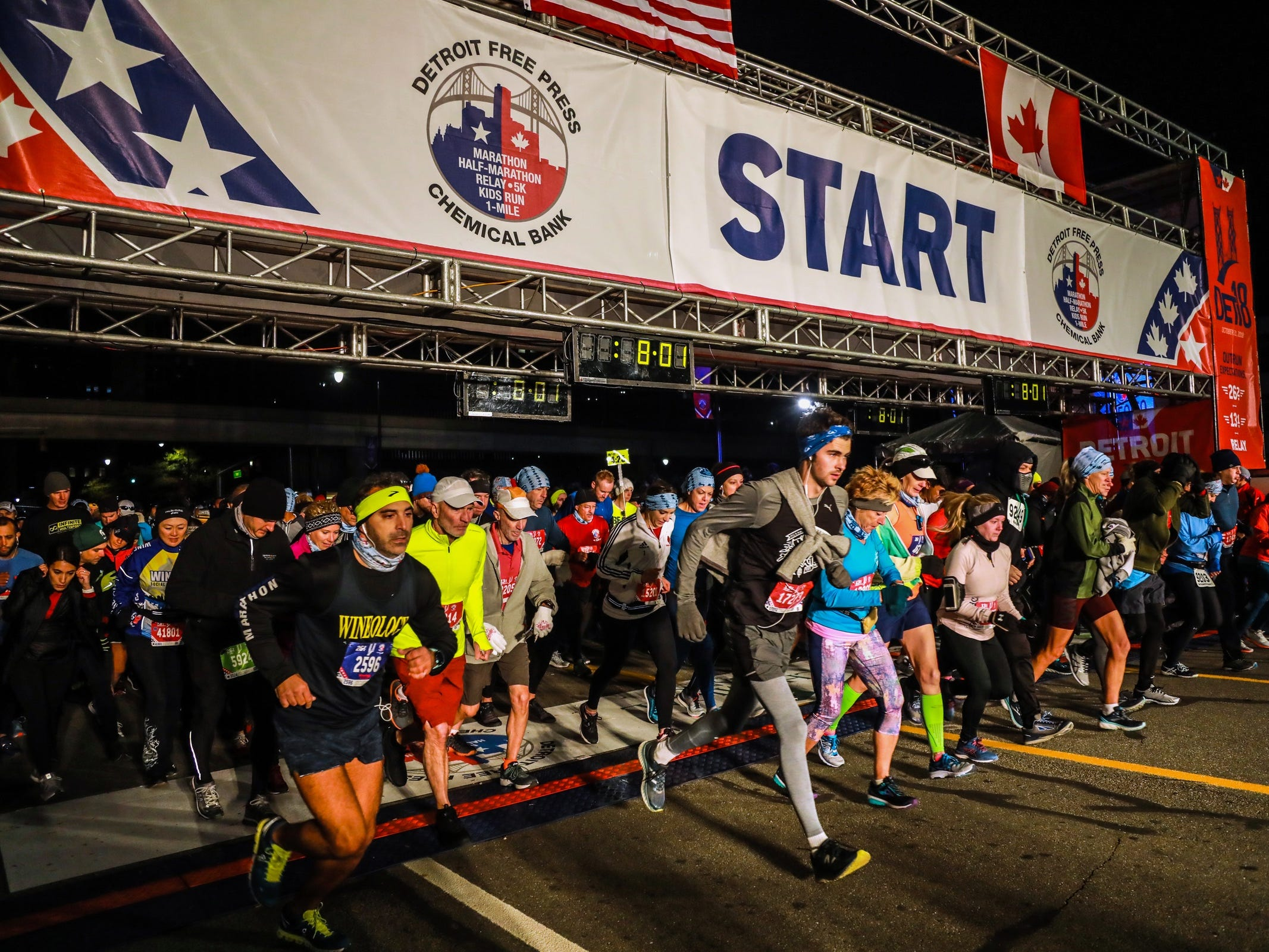 Runners take off in waves for the half and full marathon down Fort street, during the 41st Annual Detroit Free Press/Chemical Bank Marathon in Detroit on Sunday, Oct. 21, 2018.