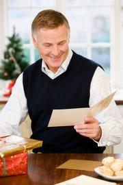 Man reading Christmas card