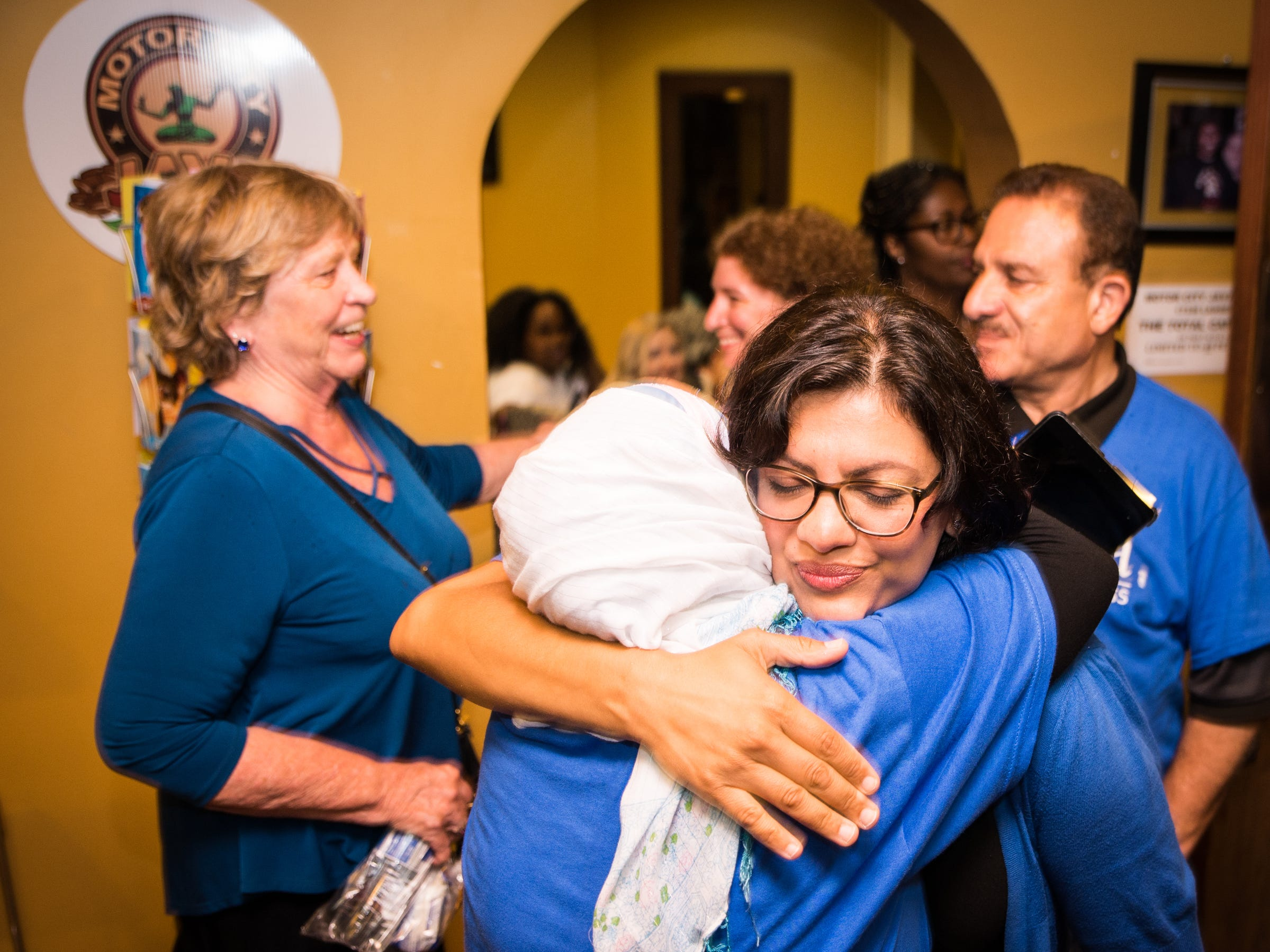 Rashida Tlaib greets supporters and family at her election night party in Northwest Detroit on Aug. 7, 2018.
