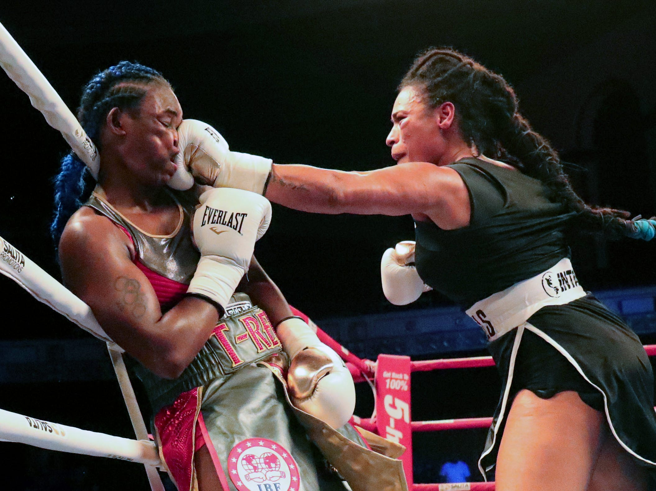 Claressa Shields takes  a punch from Hanna Gabriels during ninth round action of the IBF & WBA Middleweight World Championships Friday, June 22, 2018, at the Masonic Temple in Detroit, Mich.