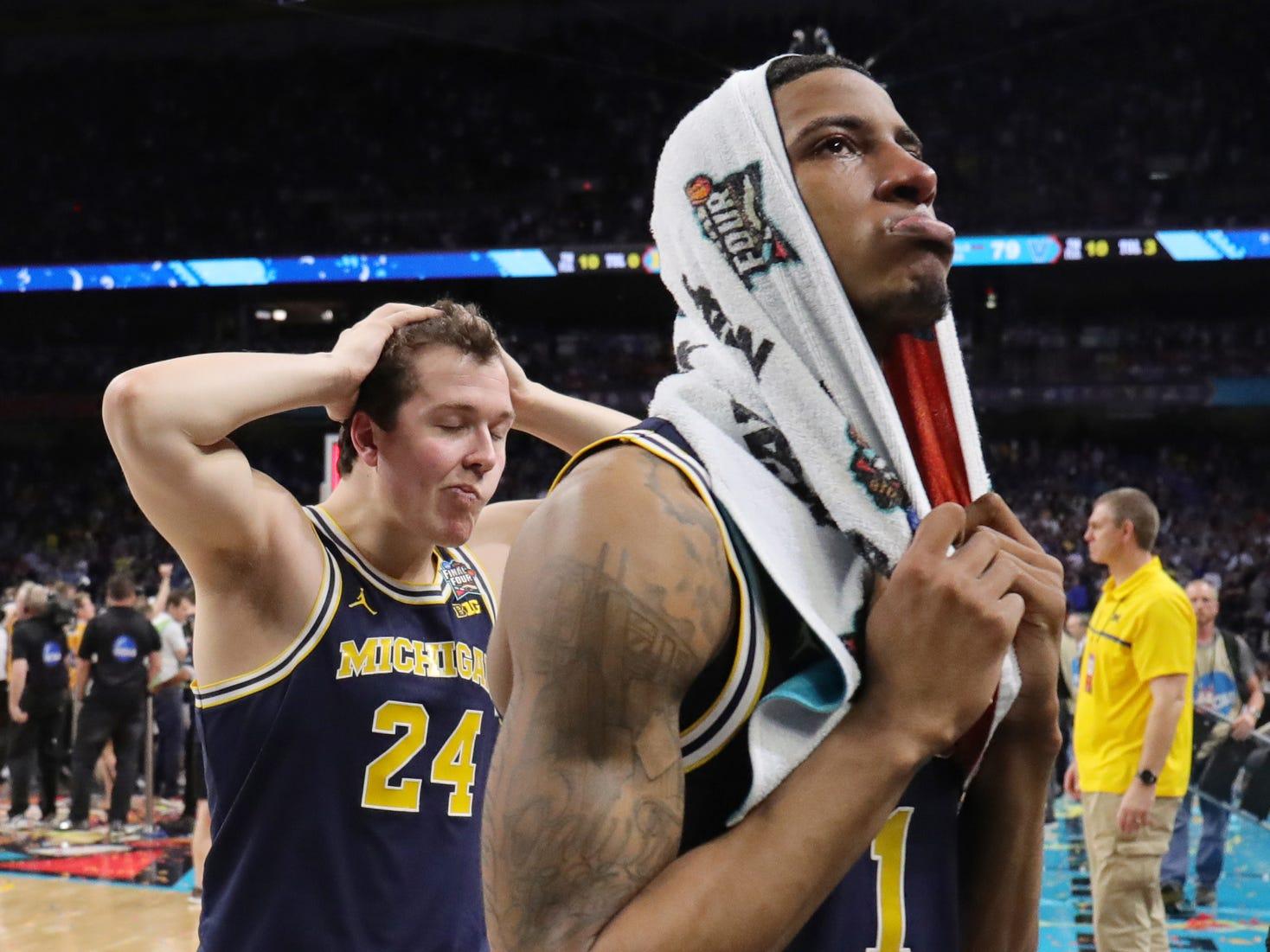 Michigan guard Charles Matthews (1) and forward C.J. Baird (24) leave the floor after losing 79-62 during the NCAA division 1 men's basketball national championship game between Michigan and Villanova on Monday, April 2, 2018, at the Alamodome in San Antonio.