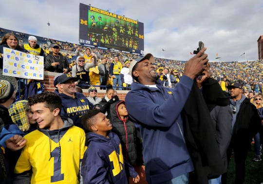 Chris Webber takes a selfie with fans prior to the start of the Michigan and Penn State game on Nov. 3, 2018, at Michigan Stadium.