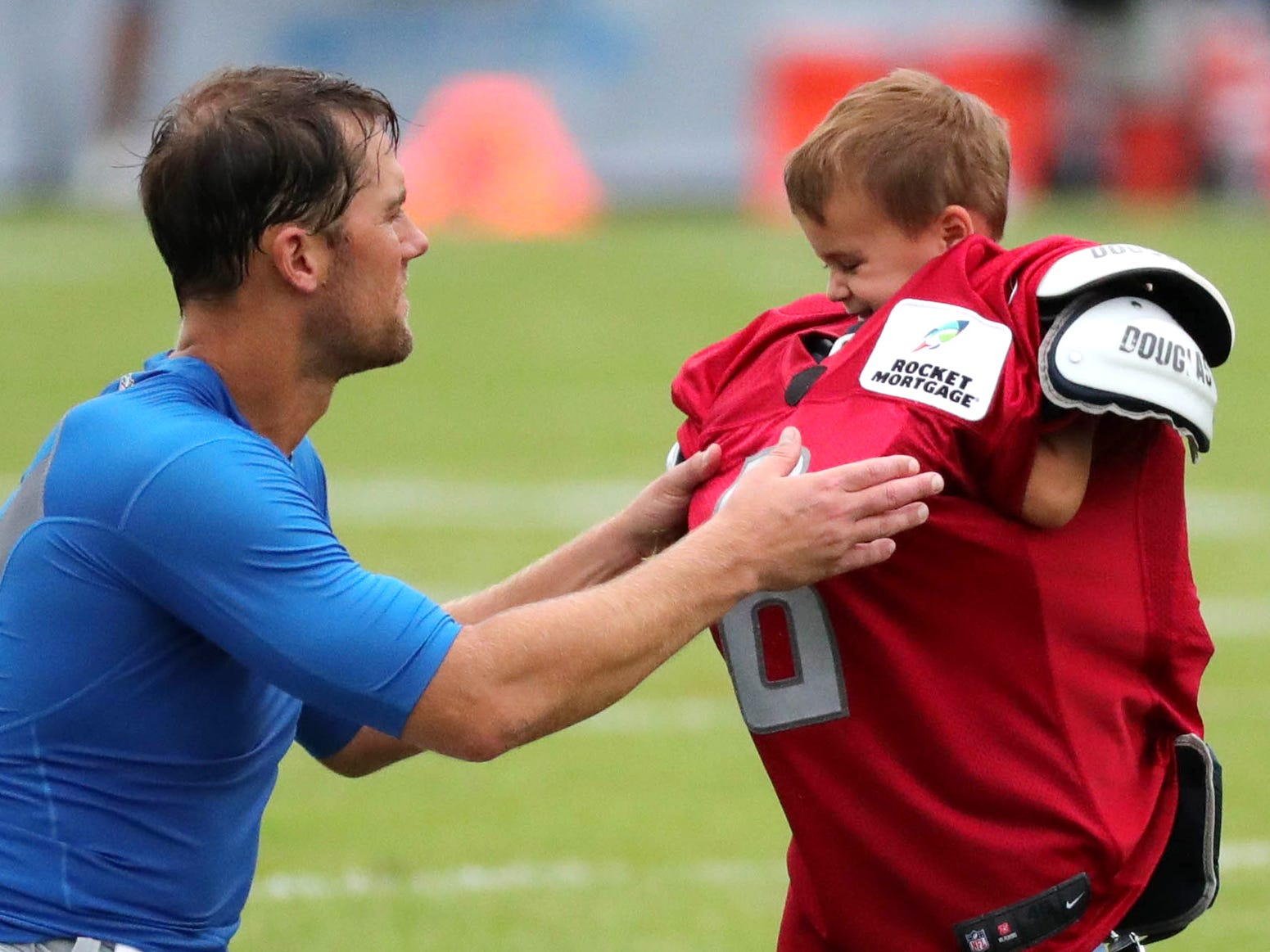 Detroit Lions quarterback Matt Cassel puts his jersey and pads on his son Clayton after practice Wednesday, August 1, 2018, at the practice facility in Allen Park, Mich.