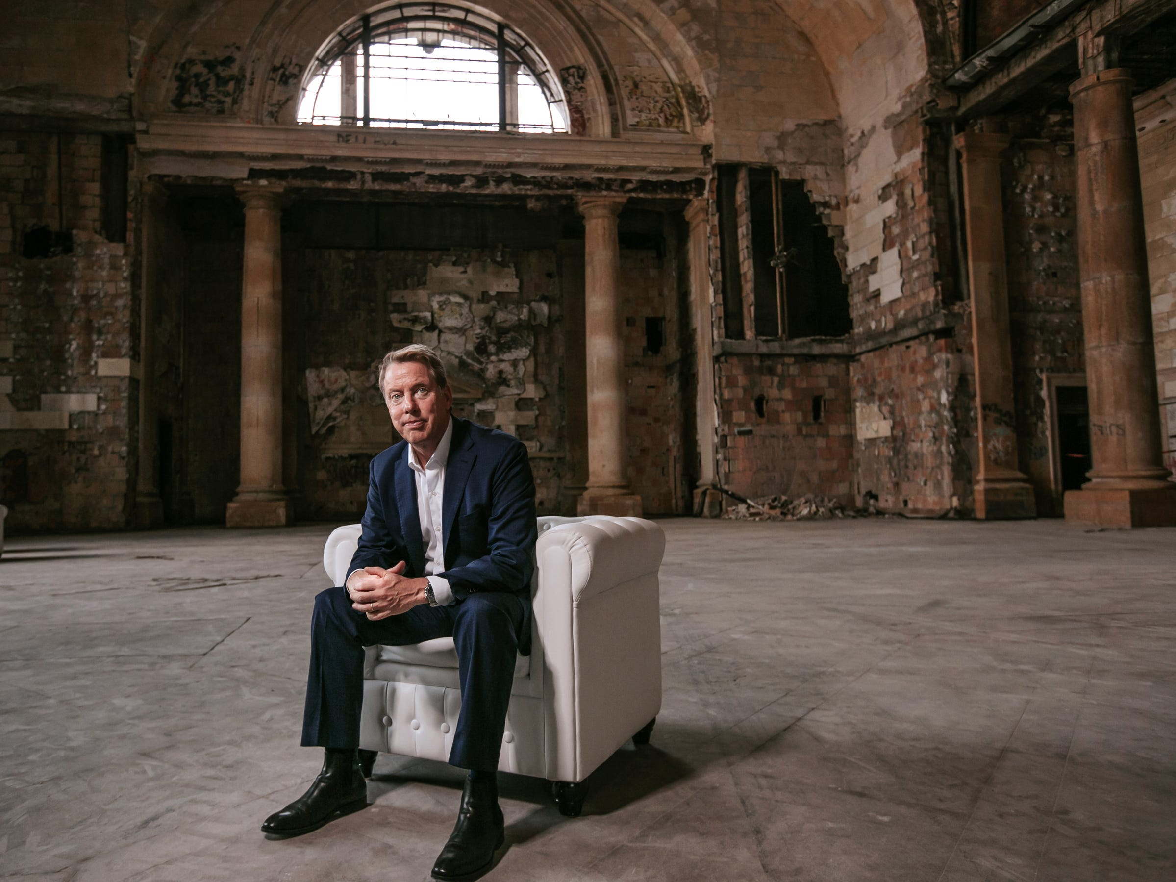 Ford Motor Co. Executive Chairman Bill Ford Jr. poses for a photo in Michigan Central Station in Detroit's Corktown neighborhood in Detroit on Wednesday, June 13, 2018.Ford recently purchased the long-vacant train station with plans to renovate and make it a hub of a campus for advanced automotive technology.
