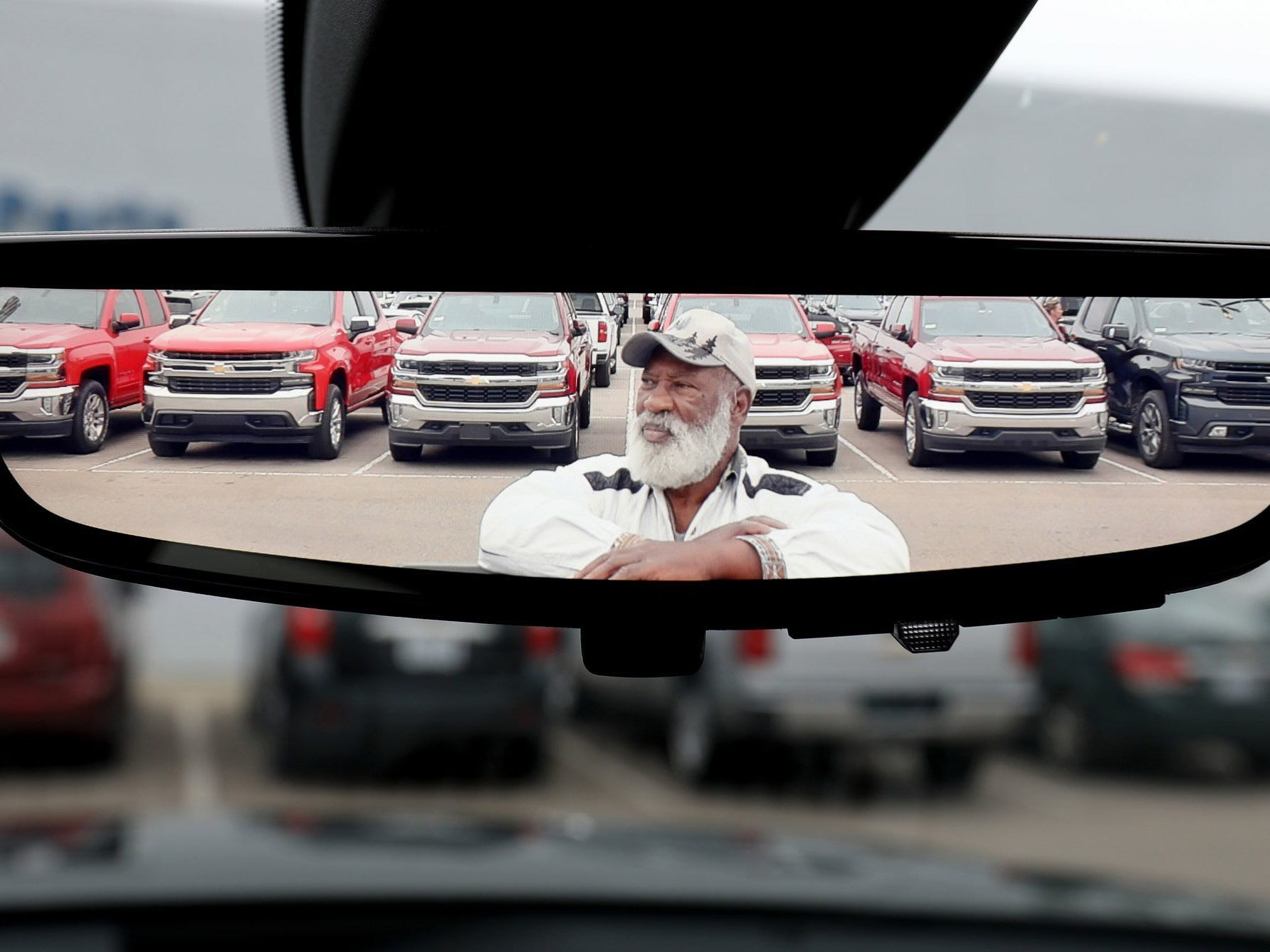 With 2018 and 2019 Chevrolet Silverados behind him, Ernest Johnson, 80 of Pontiac, is reflected in a mirror of his 2019 Chevrolet Silverado that he bought at George Matick Chevrolet in Redford Township on Thursday, September 27, 2018.